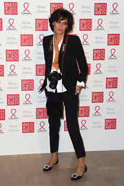 Ines de la Fressange swung a leather sling bag at the Sidaction gala dinner 2012.