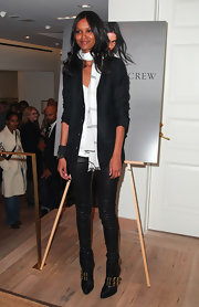 Liya Kebede attended the debut of Lemlem with J. Crew wearing a black cropped jacket over a cardigan and a low-neck shirt.