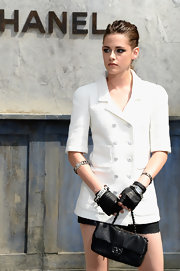 Kristen Stewart arrived for the Chanel Couture Fall 2013 show carrying a chic black sequined purse from the label.