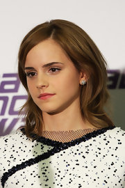 Emma Watson sported textured shoulder-length layers at the National Movie Awards.