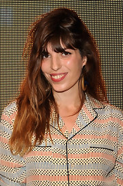 Lou Doillon styled her hair with edgy waves and wispy bangs for the Marni at H&M collection launch.