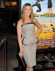 Jennifer Aniston teamed a black alligator clutch with a strapless peplum dress (both by Tom Ford) for the premiere of 'Wanderlust.'