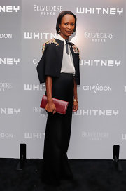 For a touch of color, Shala Monroque accessorized with a maroon leather clutch.