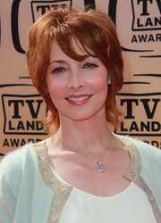 Sharon Lawrence attended the 2010 TV Land Awards wearing a layered razor cut.