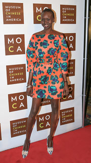 Alek Wek teamed her bold dress with a pair of black-and-white printed pumps.