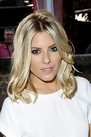 Mollie King looked oh-so-pretty with her piecey waves at the British Heart Foundation party.