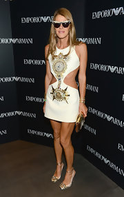 Anna dello Russo showed off her fab physique in an embellished white cutout dress by Fausto Puglisi during the Emporio Armani New York flagship opening.
