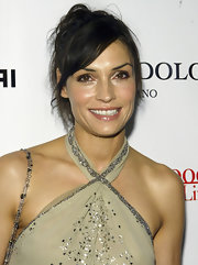 Famke Janssen tied her locks up in a messy ponytail for the Hollywood Life Breakthrough Awards.
