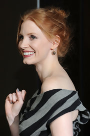 Jessica Chastain matched her monochrome dress with gray nail polish.
