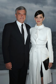 Marion Cotillard's black Dior leather clutch and white coat were a flawless pairing.