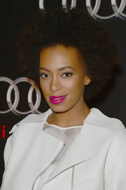 Solange Knowles wore her hair in tight curls during Audi's celebration of Super Bowl 2013.