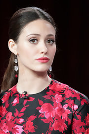 Emmy Rossum dressed up her ponytail with a pair of dangling crystal earrings.