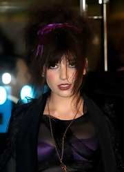 Daisy Lowe adorned her hair with a purple velvet headband (that matched her bra).