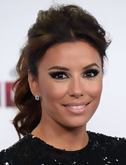 Eva Longoria amped up the edge factor with heavy eye makeup.