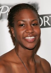 Tamika Catchings attended the Salute to Women in Sports Awards wearing her hair in a braided updo.