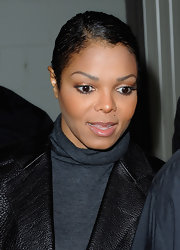 Janet Jackson wore a slicked-down 'do at the Hermes fashion show.