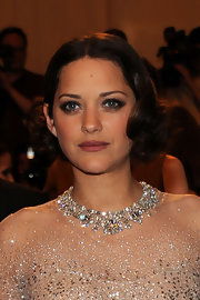 Marion Cotillard attended the Met Gala wearing vintage-chic center-parted curls.