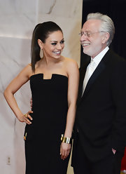 Mila Kunis attended the White House Correspondents' Association Dinner wearing an elegant gold cuff by Cartier.