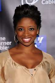 Montego Glover attended the NY1 20th anniversary celebration wearing her hair in a voluminous fauxhawk.