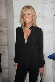 Patti Hansen looked ageless in a loose black blouse with a plunging neckline at the Couture Council Fashion Visionary Awards.