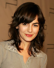 Camilla Belle wore flippy waves with side-swept bangs during the Pret a PSP event.