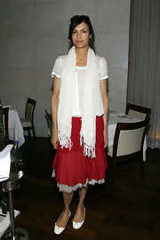 Famke Janssen unleashed her boho side wearing a sheer white top, a red skirt and a tasseled scarf to style the look.