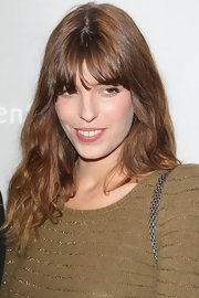 Lou Doillon attended the Chaumet cocktail party wearing her signature waves and eye-grazing bangs.