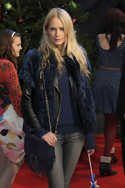 Poppy Delevingne attended the 'Arthur Christmas' UK premiere carrying a cute tasseled and fringed shoulder bag.