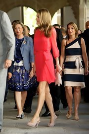 Princess Letizia completed her outfit with a pair of nude peep-toe slingbacks.