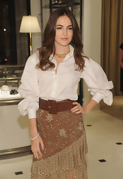 Camilla Belle's oversized brown belt put a perfect finish to her button-down and skirt ensemble at the 'World of Gloria Vanderbilt' celebration.