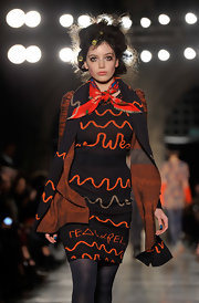 Daisy Lowe walked the Vivienne Westwood Red Label runway wearing a matchy-matchy knit scarf and sweater dress combo.