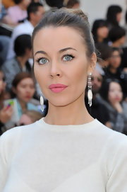 Ulyana Sergeenko complemented her updo with a pair of dangling pearl earrings.