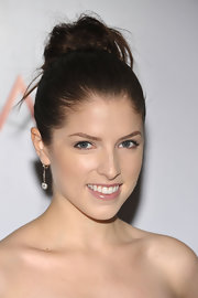 Anna Kendrick complemented her updo with a pair of dangling diamond earrings.