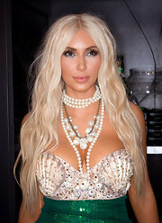 Kim Kardashian topped off her mermaid costume with a wavy blonde wig.