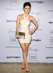 Rachel Bilson completed her head-turning getup with a Romanek feathered clutch.
