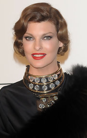 Linda Evangelista had her short hair curled to match her luxe gown for amfAR.