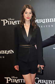 Astrid Berges Frisbey teamed an embellished, quilted clutch with a black short suit for the 'Pirates of the Caribbean: On Stranger Tides' premiere.