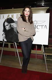 Hilary Rhoda opted for menswear-chic brown lace-up boots to complete her look.