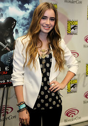 Lily Collins styled her outfit with an intricate gold pendant necklace.
