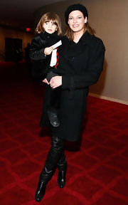 Linda Evangelista took her son to 'The Nutcracker' wearing a black wool trench coat.