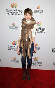 Sami Gayle bundled up in a bulky knit scarf during the Kids for Kids Family Carnival.