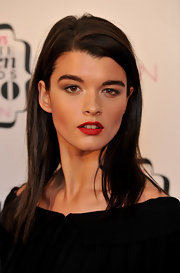 Crystal Renn's beauty look was hard to miss thanks to her bold red lipstick.