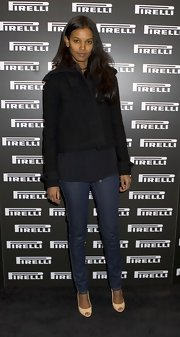 Liya Kebede bundled up in a stylish black cropped jacket for the Pirelli Calendars book launch.