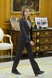 Princess Letizia went for a boyish vibe in black tassel loafers, slacks, and a leather jacket during an audience at Zarzuela Palace.