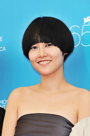 Rinko Kikuchi attended the Venice Film Festival photocall for 'The Sky Crawlers' wearing a funky bowl cut.