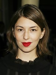 Red lipstick added a dose of sexiness to Sofia Coppola's look.