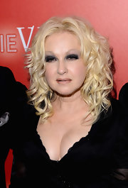 Cyndi Lauper neutralized her dark eye makeup with nude lips.