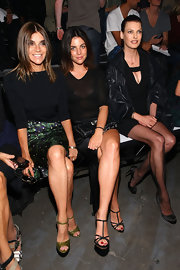 Julia Restoin-Roitfeld teamed black strappy sandals with a sheer top for a sultry look during the Alexander Wang fashion show.