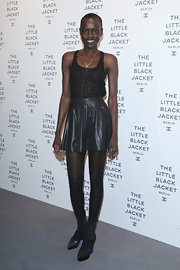 Alek Wek kept it breezy in a sheer black tank top when she attended the Chanel Little Black Jacket opening.