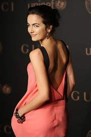 Camilla Belle attended a Gucci reception wearing a chunky charm bracelet.
